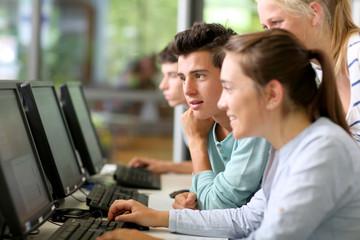 Students in class working on desktop computer