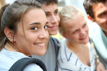Portrait of smiling school girl amongst group