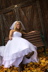 Happy Bride Sitting On Bench