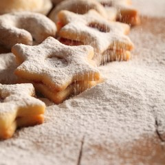 Christmas cookies and pouring sugar