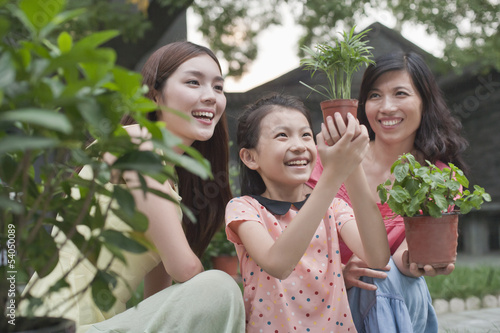 Two Women and Young Girl Gardening