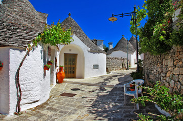 Unique Trulli houses with conical roofs in Alberobello, Italy, P