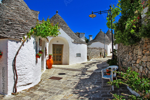 Leinwandbild Motiv Unique Trulli houses with conical roofs in Alberobello, Italy, P