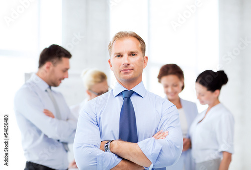 handsome businessman with team in office