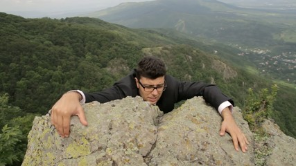 Young Businessman Hanging Danger Climbing Up Success