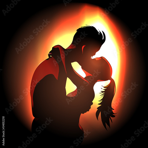 Passionate young couple over fire light