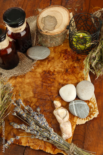 Composition with old papers, herbs, stones and bottles with