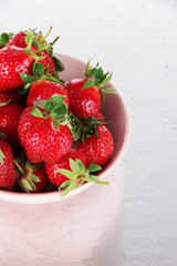 Strawberries in bowl on metal background