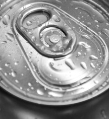 Macro shot of can with water drops