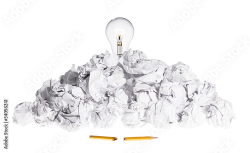 Problem Solving Concept Light Bulb On Pile of Crumpled Paper