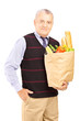 Gentleman holding a paper bag full of food