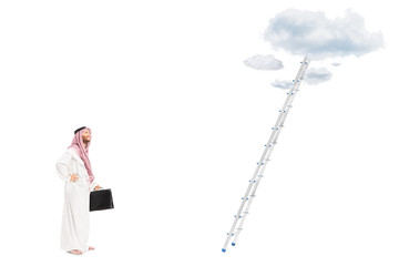 Male arab person in front of ladder with clouds in the heights