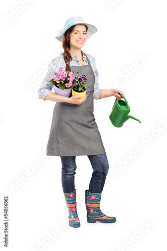 Full length portrait of a female gardener holding flower pots