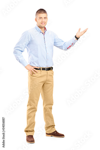 Full length portrait of a young handsome guy gesturing