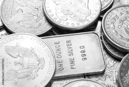 Silver coins and bars macro shot