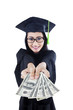 Asian female graduate holding money on white