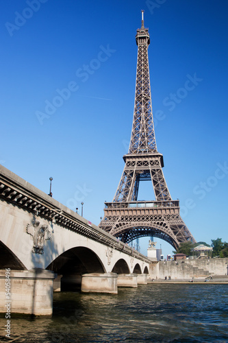 Eiffel Tower and bridge on Seine river in Paris, France.