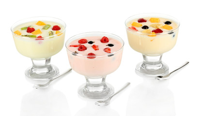 Delicious yogurt with fruit isolated on white