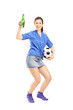 Full length portrait of a happy female fan holding a beer bottle