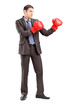Full length portrait of a businessman in suit with boxing gloves