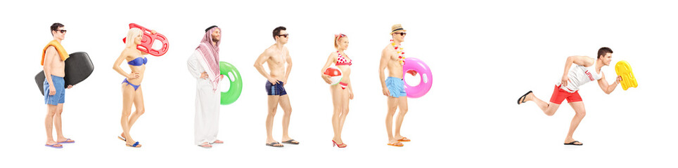 Full length portrait of young people with summer objects