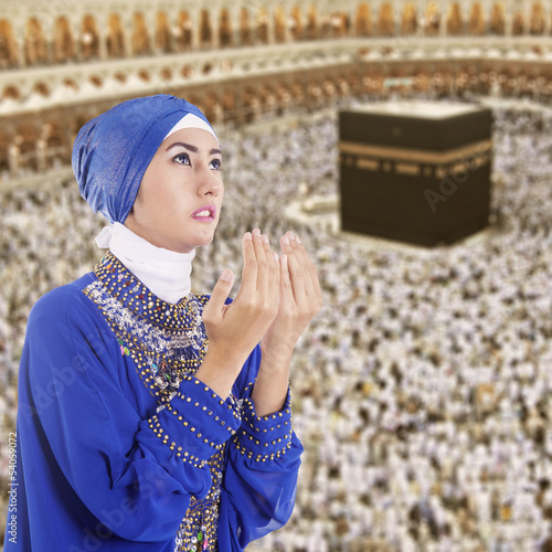 Beautiful muslim woman in blue at Kaaba, Saudi Arabia