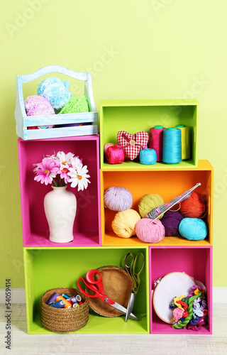 Colorful shelves of different colors with utensils