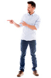 Casual man pointing to the side