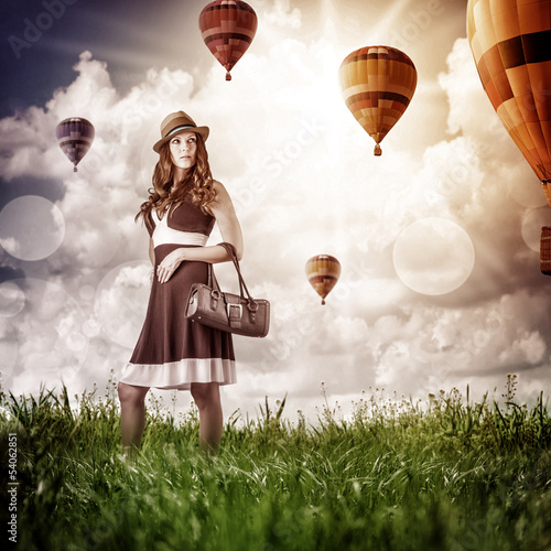 fashion woman  looking to flying aerostats