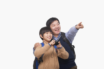 Father pointing with son holding digital camera