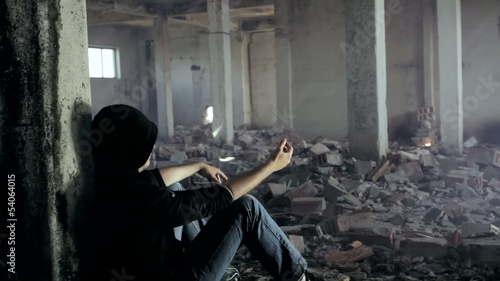 Drug Addict getting High in an Abandoned Building Dramatic Crane