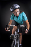 professional female athlete riding a bike, studio shot. isolated
