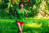 beautiful healthy brunette young woman athlete running outdoors,