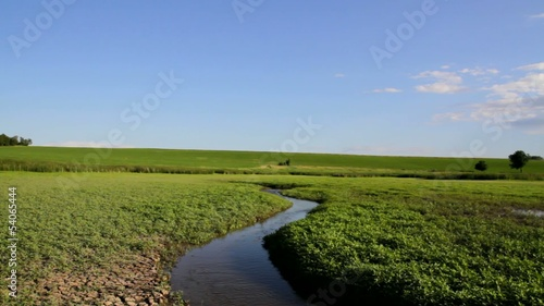 Beautiful Nature Fresh Stream In Green Field Crane Shot Nature
