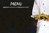 Fototapety Chef with healthy salad food on chalk blackboard menu background