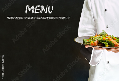 canvas print picture Chef with healthy salad food on chalk blackboard menu background