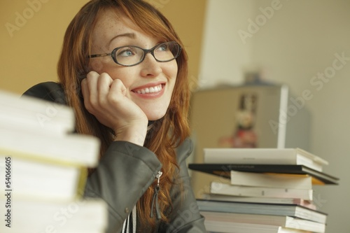 Young woman smiling while studying