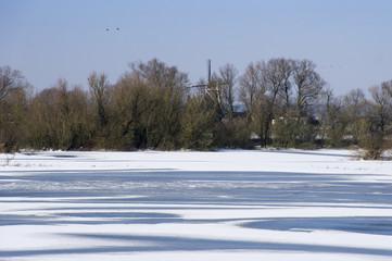 Windmill in snowy landscape in Holland
