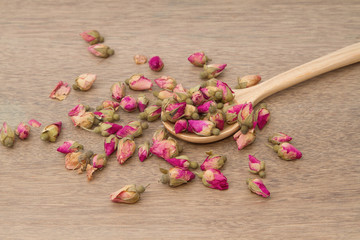Rose Tea ,dried rose buds tea in wooden spoon