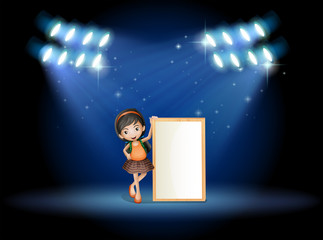 A stage with a young girl holding an empty signboard