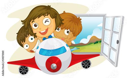 Happy children riding on a jetplane
