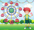 A boy holding a lollipop beside a ferris wheel