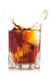 Splash of brown beverage