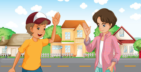 Two boys meeting across the big houses at the road