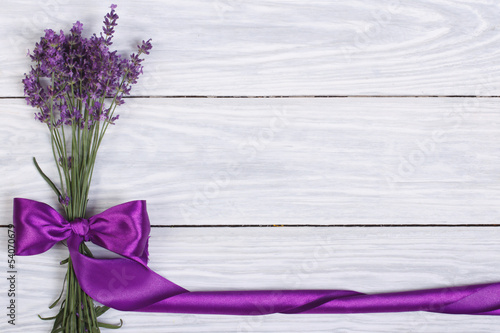 Foto op Canvas Lilac floral frame from flowers of lavender and purple ribbon