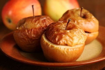 Close-up of baked apples with fresh apples