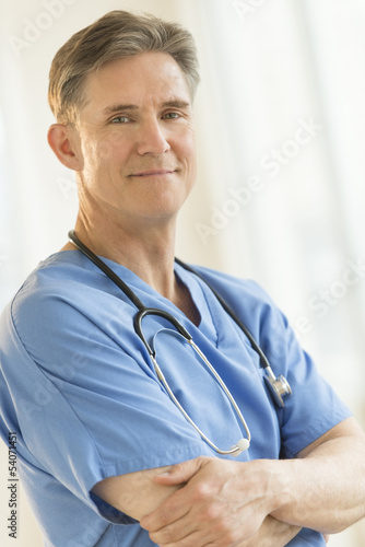 Confident Male Surgeon Standing Arms Crossed