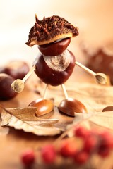 Chestnut and acorn figurine on wooden table