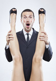 young businessman holding woman's legs, humorous sex scene