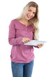 Happy woman using tablet pc
